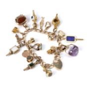 Victorian 15ct gold charm bracelet each link stamped '15 625' with a later 9ct gold heart padlock