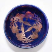 Jonathan Chiswell Jones (b.1944) 'The three hares' blue bowl with copper lustre decoration, signed