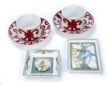 Pair of Hermès porcelain teacups and saucers in the 'Balcon Du Guadalquivir' pattern, stamped to the