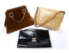 Three Louis Vuitton handbags one a bronze monogram 'Vernis Forsyth GM' handbag, 31cm overall, the