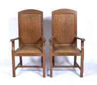 In the manner of Brynmawr pair of oak wainscot or armchairs with drop-in seats, unmarked, 119cm high