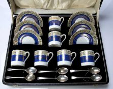 Cased set of Rosenthal coffee cans and saucers with silver spoons, with white, blue and cream banded