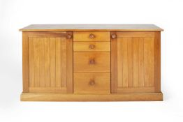 Cotswold School cherrywood sideboard, consisting of four graduated drawers flanked by two cupboards,