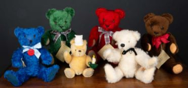 A group of four teddy bears by 'Grisly' in various colours, the largest 38cm high together with a