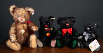 A group of four Steiff teddy bears consisting of a modern Steiff replica of a 1927 Petsy bear