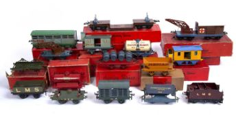A collection of Hornby series O gauge rolling stock to include a barrel wagon, United Dairies tank