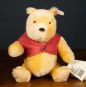 A Steiff Winnie the Pooh bear numbered 5567/10000, with original packagingCondition report: At