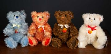 A group of four Steiff teddy bears representing the four elements, earth, fire, air and water,