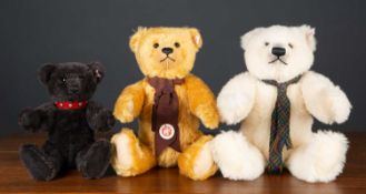 Three Steiff teddy bears consisting of a polar ted with a woven scarf, 38cm high together with a