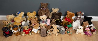 A collection of thirty one various soft toys and teddy bears by a variety of makers to include