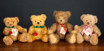 A group of four Hermann musical teddy bears consisting of a UK bear 2003, 34cm high; a UK 2008