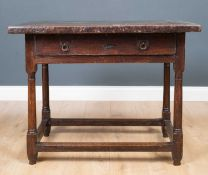 A late 17th / early 18th century oak side table with a single frieze drawer, turned supports