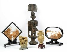 An early 20th century Nigerian carved and painted wooden figure 44cm in height together with two