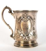 A Victorian silver small tankard decorated with Bacchanalian revellers and with a cartouche engraved