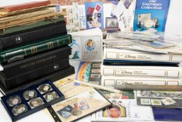 A collection of first day covers in three albums of The Disney World of Postage Stamps, a small