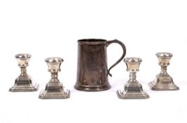 A set of four small silver candlesticks each 7.5cm in height together with a silver half pint