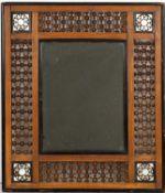 A Georgian mahogany fret framed wall mirror, 58cm x 37cm together with an Eastern style ebonised