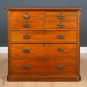 An Edwardian walnut chest of one deep, two short and three long drawers raised on a plinth base,