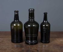 An 18th century green glass bottle with a crown seal, 9cm diameter at the base x 28cm high
