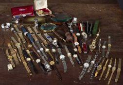 A mixed group of pens, wrist watches and two magnifying glasses Condition report: At present,