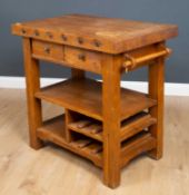 A modern oak kitchen side table in the style of a butchers block with two drawers to either side