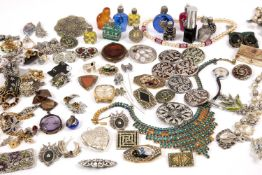A collection of costume jewellery to include assorted necklaces, bracelets, brooches etc and some