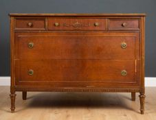 A continental walnut chest of three short and two long drawers 122cm wide x 56cm deep x 88.5cm