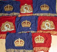 Eight Royal Coronation banners in gilded card, mounted on cotton, four in blue and four in red,