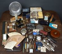 A box of miscellaneous items to include a silver backed handmirror, a group of opera glasses, a