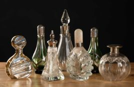 Four 1970's silver overlaid glass scent bottles to include a pair of green glass examples, all