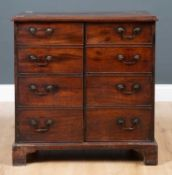 A George III mahogany commode chest converted to a cupboard, having six faux drawers with brass swan