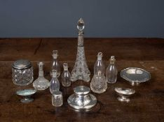 A quantity of silver and glass items to include an Eiffel tower perfume bottle, a dish and an ink