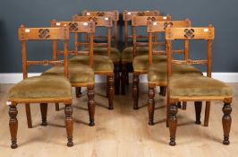 A set of eight Victorian carved oak dining chairs with green upholstered seats and turned