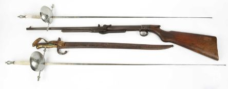 An early 20th century air rifle marked L3079, 101cm in length together with a late 19th century