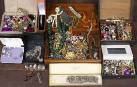 A collection of costume jewellery to include a silver bangle and an amber necklaceCondition