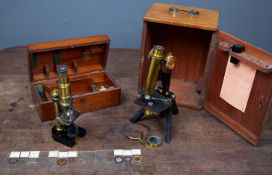 A 19th century students microscope in a fitted walnut box, 28cm in height; a further microscope