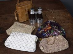 A pair of Cam LaFontaine Optician binoculars in a leather case together with four bead evening