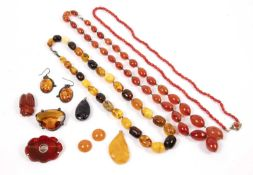 A collection of jewellery, comprising an amber and heat-treated amber single strand bead necklace, a