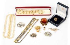 A Georg Jensen silver kneeling deer brooch, 4.5cm wide; a 9 carat gold citrine ring; an agate gilt