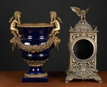 A continental blue porcelain and gilt metal mounted urn with cherub mounts, 26cm wide x 35.5cm