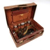 A 19th century crocodile leather vanity case by Finnegans Limited, containing a quantity of silver
