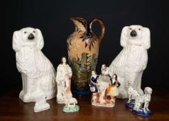 A Doulton stoneware ewer 42cm high together with two Staffordshire flatback spaniels, 38cm high