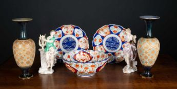 Two antique continental porcelain figurines with marks to the base together with two Japanese
