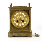 An antique French brass mantle clock with a mercury barometer dial, the enamelled and gilded clock