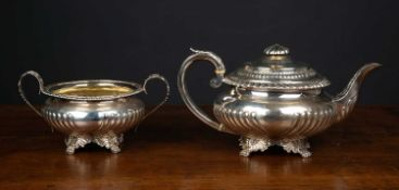 A silver teapot and matching bowl both with reeded decoration and acanthus leaf styling, the