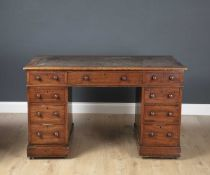 A Victorian mahogany pedestal desk with leather inset top and turned knob handles, 122cm wide x 63.
