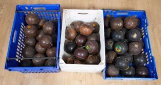 Three crates of lignum vitae and composite lawn bowls approximately twenty three lignum vitae the