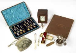 A cased group of twelve silver teaspoons, a small silver jug and other miscellaneous silver, a