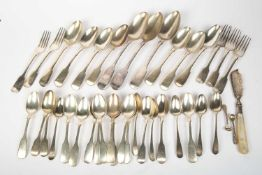 A group of Victorian silver fiddle pattern spoons, forks and teaspoons, six Georgian teaspoons, a