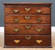 A Georgian mahogany small size chest of four long drawers with brass swan neck handles, 74cm wide